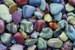 Thumbnail colorful pebbles at the shore of McDonald Lake Glacier National Park Montana USA