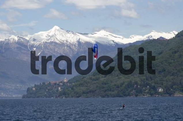 Product picture at the Lake Maggiore Lago Maggiore Piedmont Piemonte Italy kite surfing in front of the snowcovered mountains from the tessin ticino