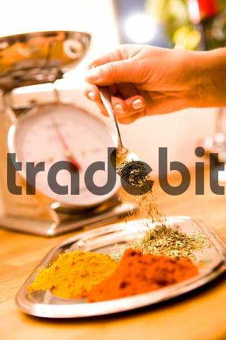 Product picture spices with kitchen weighing scales paprika powder curry